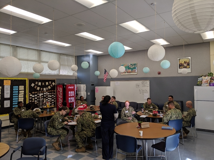Navy personnel gather for Read Across America.