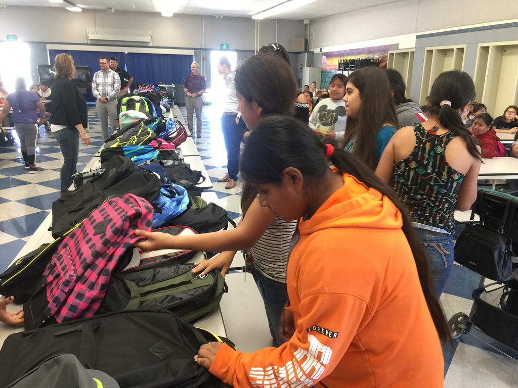 Students selecting their backpack